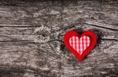 Red plush heart on wooden background — Stock Photo