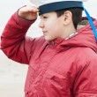 Boy in a peaky cap of the sea cabin boy — Stock Photo #64681469