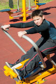 The boy on outdoor sport ground — Stock Photo