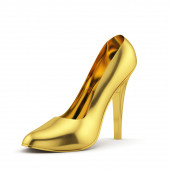 Golden high heel on white background isolated — Zdjęcie stockowe