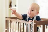 Baby boy in crib — Stock Photo