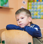 School boy in classroom at lesson — Stock Photo