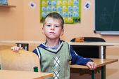 School boy in classroom at lesson — ストック写真