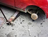 Repair car brake in garage — Stock Photo