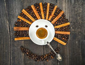 Smiling face made from cup of fresh coffee and beans — Stock Photo