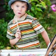 Little boy draws a picture outdoor — Stock Photo #74203457