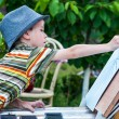 Little boy draws a picture outdoor — Stock Photo #74203395