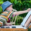 Little boy draws a picture outdoor — Stock Photo #74203397