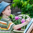 Little boy draws a picture outdoor — Stock Photo #74203429