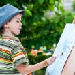 Little boy draws a picture outdoor — Stock Photo #74203439