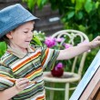 Little boy draws a picture outdoor — Stock Photo #74203443