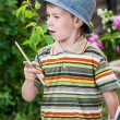 Little boy draws a picture outdoor — Stock Photo #74203497