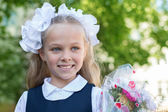 First grader girl with bows  — Stock Photo