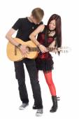 Interracial young couple music — Stock Photo