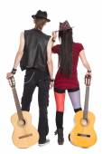 Young girl and guy with the guitars — Stockfoto