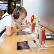 Постер, плакат: Boy in Apple store in Hong Kong