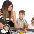 Young mother playing with her children — Stock Photo #54661207