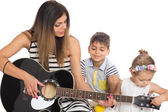 Young mother playing with her children — Stock Photo