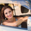 Woman behind the wheel of a car — Stock Photo #55436889