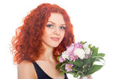 Red haired girl with flowers — Stock Photo