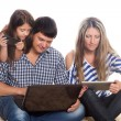 Father using a laptop, tablet PC, smartphone — Stock Photo #55945123