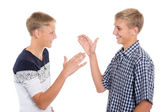 Young cute brothers greet  — Stock Photo