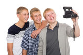 Friends make self on old camera instant print — Stock Photo