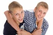 Twin brothers jokingly hugging each other — Foto Stock