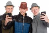 Friends posing for a self in hat — Stock Photo