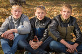 Group of guys in the autumn park — Stock Photo