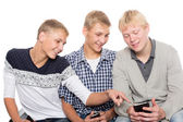 Young men use smartphones  — Photo