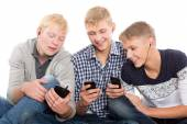 Friends use smartphones sitting  — Foto Stock
