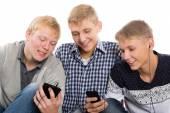 Three best friends use smartphones — Stock Photo