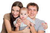 Young parents hugging beloved son — Stock Photo