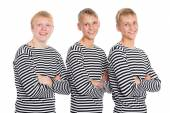 Guys blondes in a striped shirt with arms crossed — Stockfoto