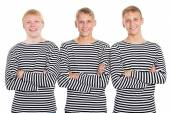 Smiling guys in a striped shirt with arms crossed — Стоковое фото