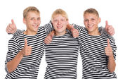 Smiling guys with raised thumbs — Стоковое фото