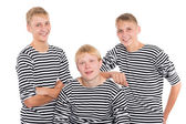 Group of smiling yong men in striped shirt  — Stockfoto