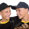 Close-up portrait of brothers baseball players — Stock Photo #58230831
