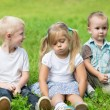 Happy children are resting on the lawn — Stock Photo #62336791