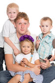 Younger brothers and sister with elder brother — Stock Photo