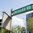 Street sign Orchard Road in Singapore — Stock Photo #68900597