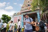 European tourist on background indian temple, Singapore — Stock Photo