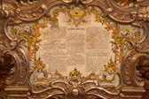 Sacrum Convivium document framed in golden baroque frame — Stock Photo