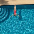 Woman Swimming and Relaxing In Pool — Stock Photo #70645611