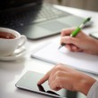 Woman hands with tablet PC and notepad at office — Stock Photo #64786277