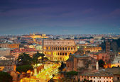 Colosseum in Rome after sunse with citylights — Stock Photo