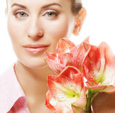 Beautiful woman with flowers — Stock Photo