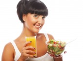 Young woman with salad and orange juice — Stock Photo