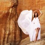 Brunette woman in white dress — Stock Photo #53949727